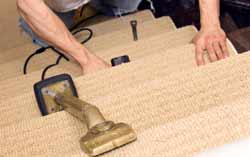 Fitting stair carpet using a knee kicker