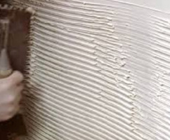 Use a notched trowel to lay the tile adhesive on at a uniform thickness