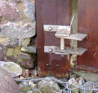 Gate hinge chemically fixed