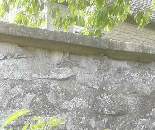 Coping stone overhang on top of wall