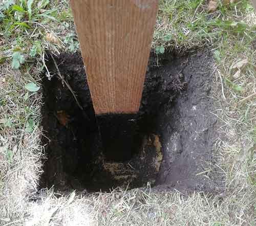 Fence post holes dug