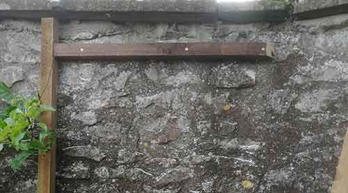 Rear horizontal timber fixed to wall