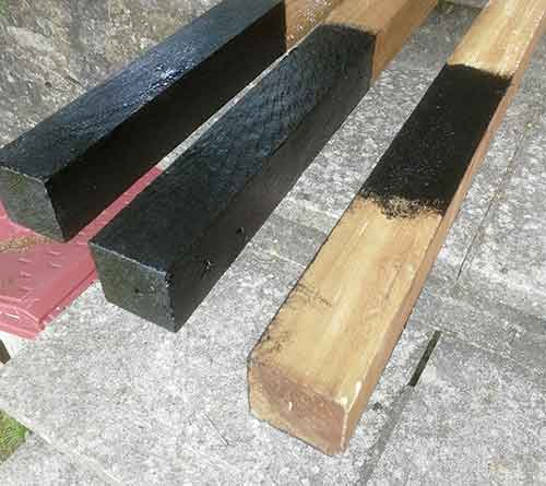 POsts treated with bitumen paint