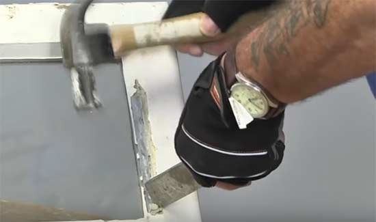 Get hacking knife right down into the corners to remove window putty