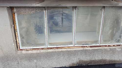 Old galavlised steel window needing putty repair