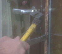 Using a hacking knife to remove putty