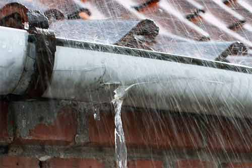 how to clean gutters from a ladder or ground level and maintain them diy doctor. Black Bedroom Furniture Sets. Home Design Ideas