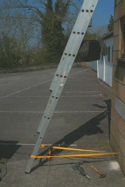 Ladder secured with ladder strap