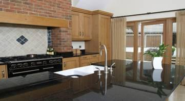 Sealed and polished black granite kitchen work surface