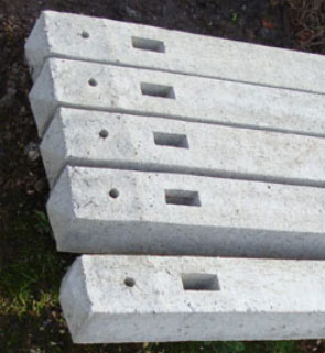 Notches in concrete fence posts for inserting rails into