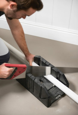 Cutting coving with a mitre block for an accurate corner