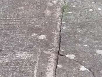Crack in concrete path caused by bad joint