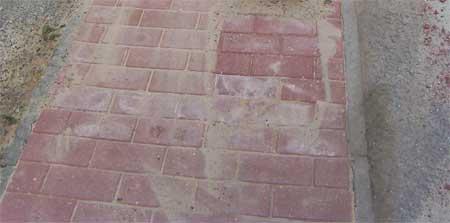 Block paving path laid to concrete edging stones