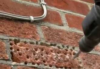 Removing a single paving brick as you would a wall brick