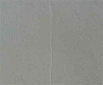 Filling fine, surface cracks in plaster and paint