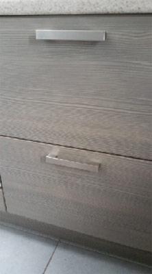 Handles mounted on kitchen cupboard door
