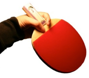 Hold brush as you would a table tennis bat