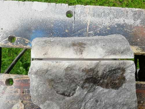 Final cut made to natural stone using angle grinder