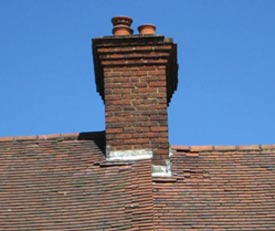 Broken roof tiles can allow damp into your roof timbers