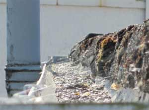 Blocked guttering can cause water to overflow