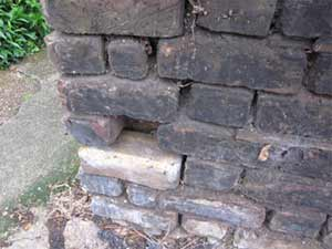 Brick wall with mortar joints missing