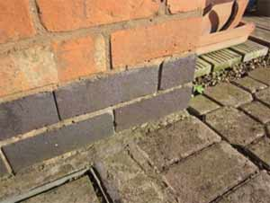 Engineering bricks used as a damp proof course