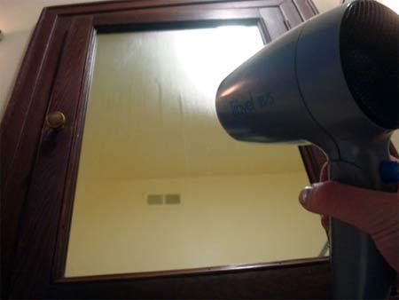 Demisting a mirror with a hair drier