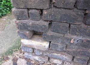 Missing or broken mortar can allow water into your wall, causing damp