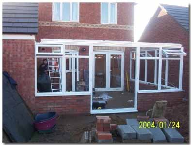All upvc conservatory modules fixed in place including door module