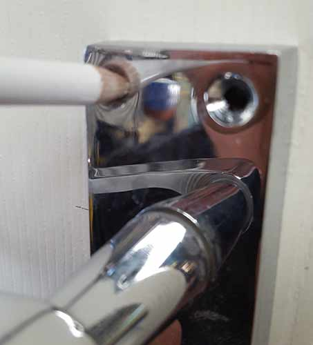 Marking door handle screw holes