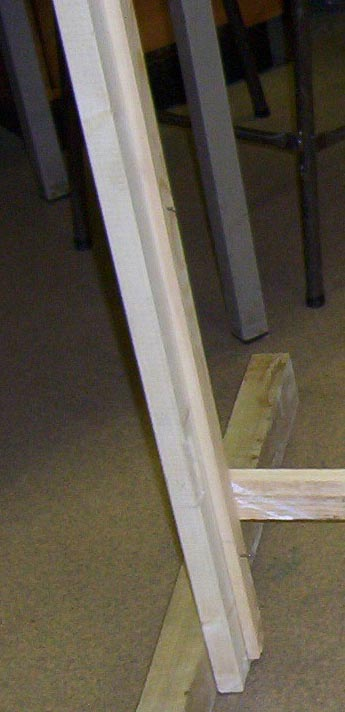 Timber fixed at base of jambs to keep it square