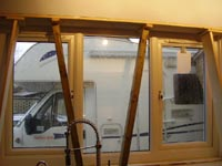 Timber pinned in position in window recess