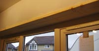 Finished timber fixed in position in window recess