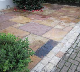 Coloured paving slab driveway