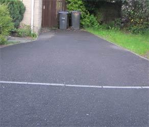 Narrow tarmac driveway