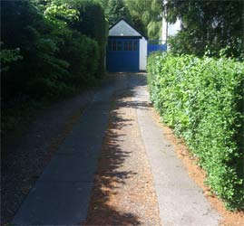 Track driveway leading to garage