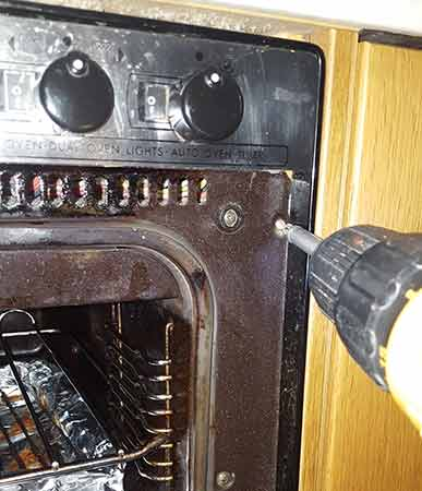 Remove retaining screws from oven