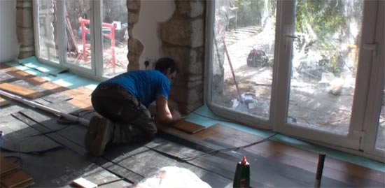 Laying floor all the way across the room