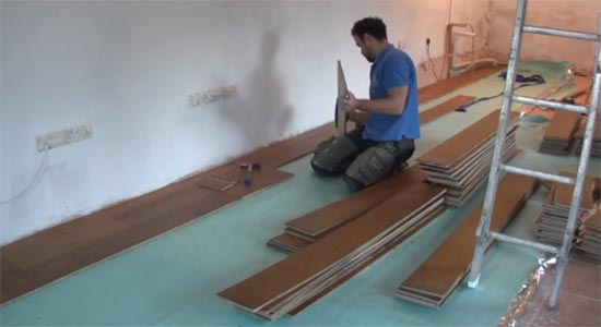 Lay the remaining floorboards across the floor