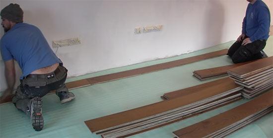 Start laying down engineered floorboards