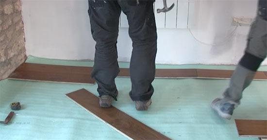 Start laying second row of flooring