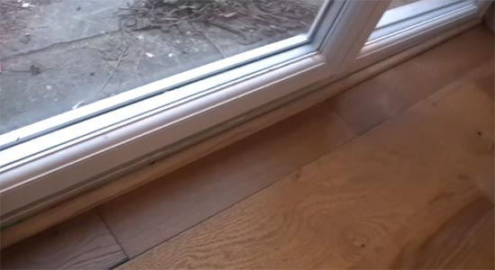 Timber quadrant across door threshold