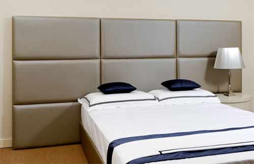 Padded fabric wall panel headboard