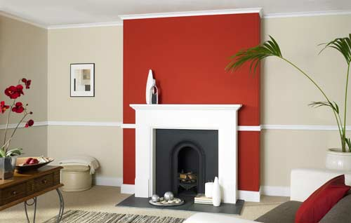 Red feature wall around fireplace