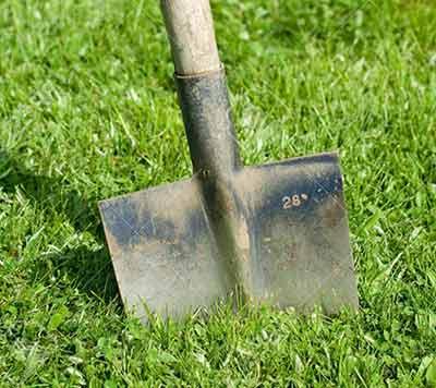 Cut turf to mark hole