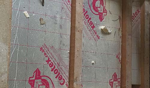 Solid insulation in a ceiling void