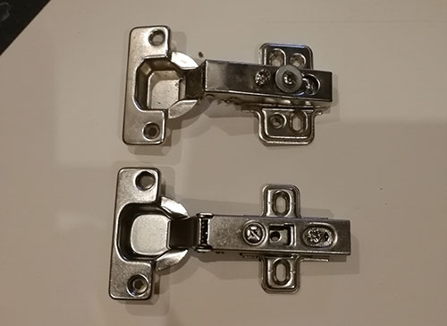 Comparing 2 different designs of 35mm concealed hinge