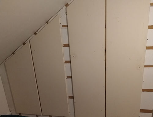 Doors fitted to cupboard using concealed hinges