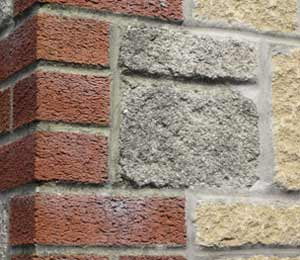 Masonry wall with brick and stone
