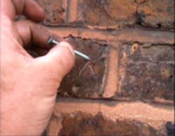 Mark the wall with a nail where you want to drill